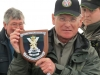 Peter Thomason (TWFFS Chair) with a mounted Regimental Plaque